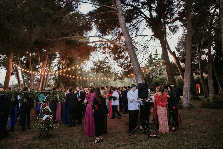 Outdoor Reception with Festoon Lights | Authentic Spanish Wedding at Masia Ribas, Barcelona | Sara Lobla Photography