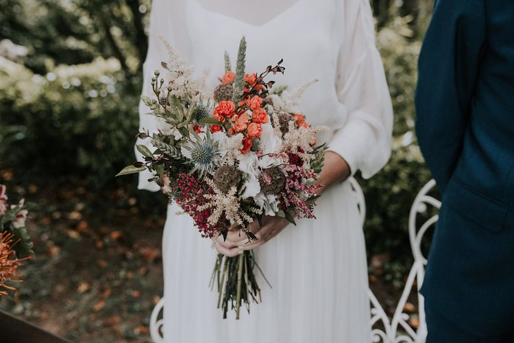 Bouquet With Orange Flowers // Bamboo Furniture For Destination Wedding In Spain With Planning From El Mono Con Sombrero With Images By AHR Photos Spanish Wedding Photography