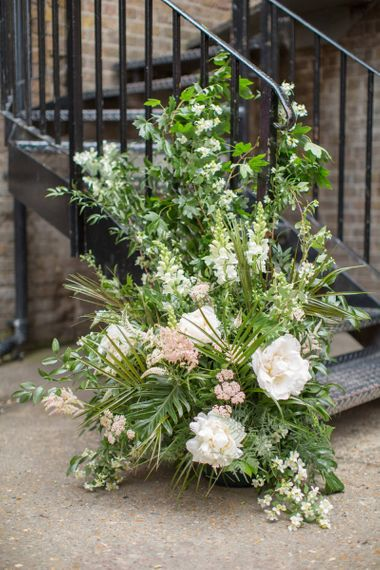 Green, White and Pink Wedding Flowers to Decorate Bottom of Stairs