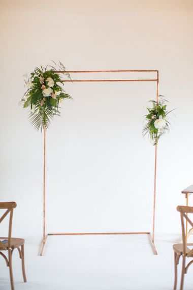 Copper Frame Altar Decorated with Botanical Green, White and Pink Flowers