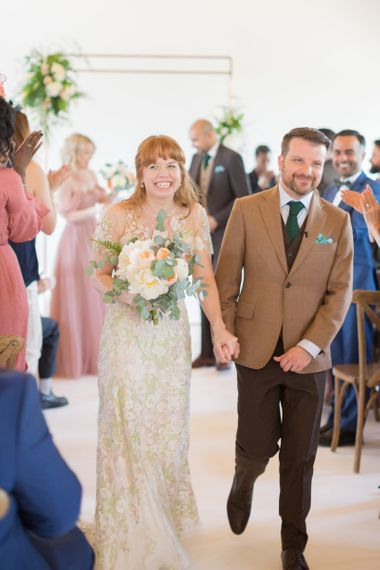 Bride in Jenny Packham Cassiopeia Wedding Dress with Groom in Brown Trousers and Blazer Just Married