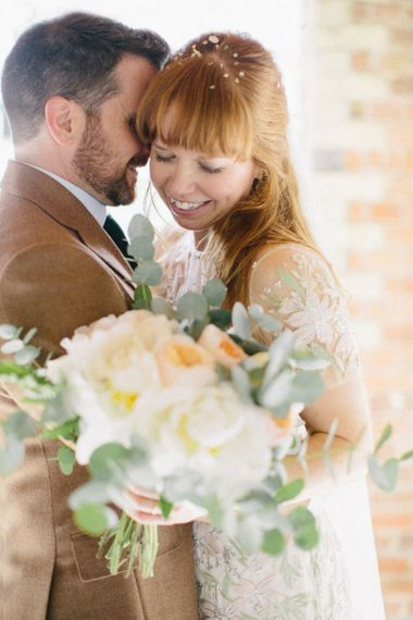 Bride in Floral Jenny Packham Wedding Dress and Groom in Brown Suit