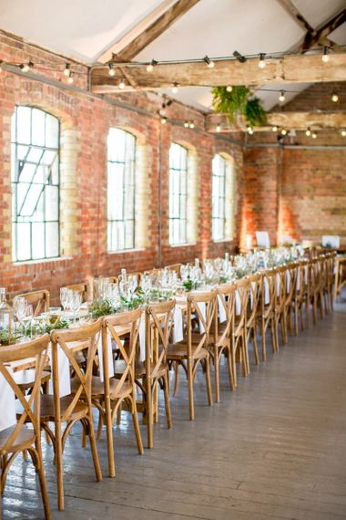 Industrial Wedding Reception at Loft Studio's with Wooden Tables and Chairs and Botanical Flowers