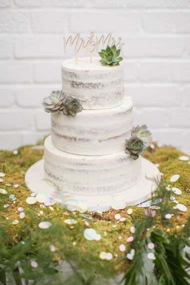 Semi Naked Wedding Cake on a Bed of Moss and Decorated with Succulents