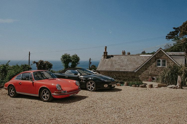 Classic wedding cars at summer English country wedding in the Isle of Wight