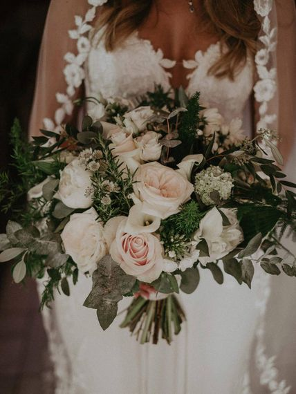 White wedding flowers with green foliage detailing