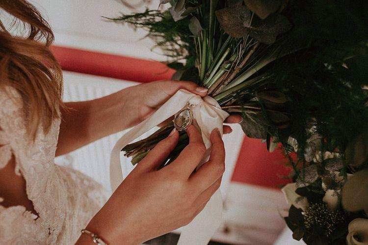 Wedding ring detailing on ribbon of wedding bouquet