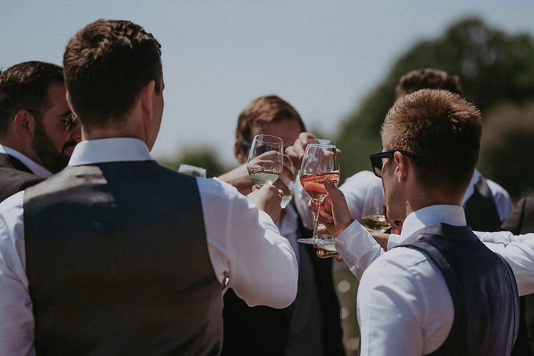 Groom and his groomsmen toasting before the ceremony