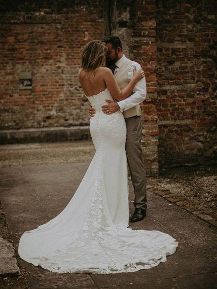 Back of brides lace, strapless Pronovias wedding dress