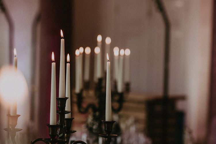 Candlestick centrepieces for classic decor at English country wedding