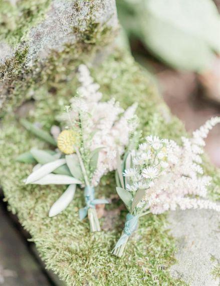White astilbe buttonholes at Marble Wedding Cake Wedding