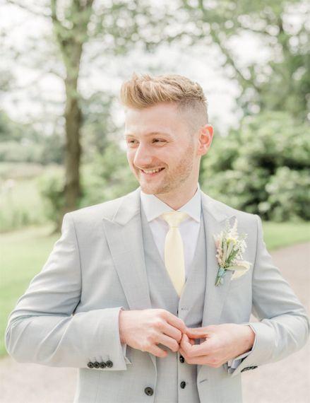 Groom in Grey Suit with Lemon Tie for Marble Cake Wedding