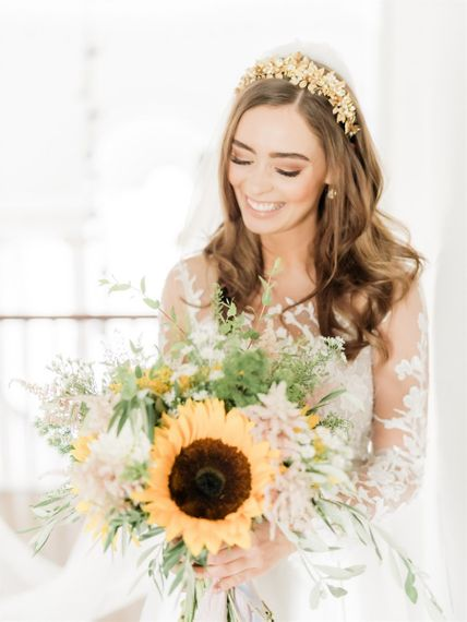 Beautifully Bride in Gold Crown Holding a Giant Sunflower Wedding Bouquet