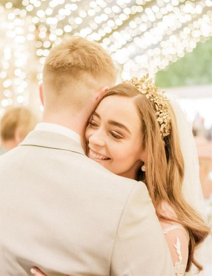 Bride In Gold Crown Embracing Her Husband