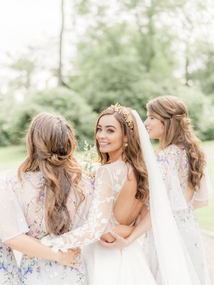 Bride in Open Back Emma Beaumont Wedding Dress with Long Sleeves