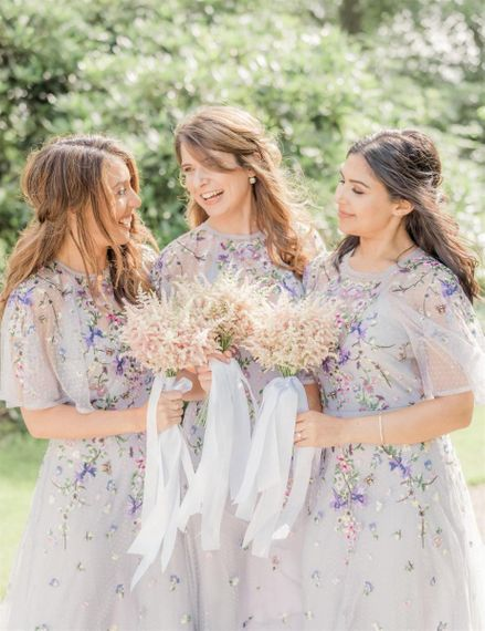 Bridesmaids In Pastel Floral Dresses With Astilbe Bouquets