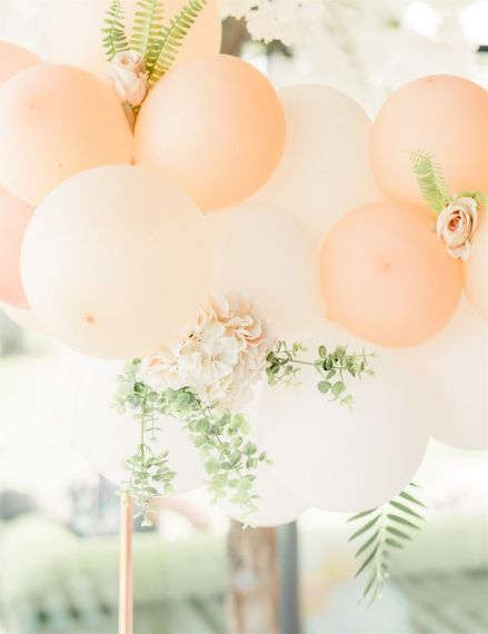 Peach and Coral Balloon Arch over Marble Wedding Cake Table