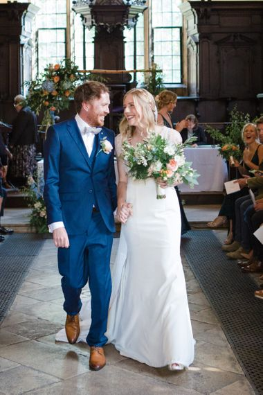 Bride in Sassi Holford Tamara Wedding Dress and Groom in Navy Blue Ted Baker Suit Happily Married