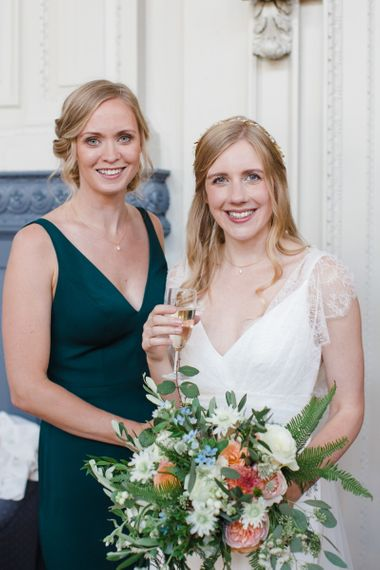Bride in Sassi Holford Tamara Wedding Dress and Bridesmaid in Forest Green Jenny Yoo  Dress