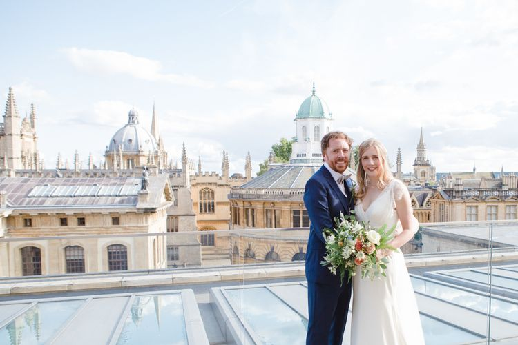 Bride in Sassi Holford Tamara Wedding Dress and Groom in Navy Ted Baker Suit with Views of Oxford