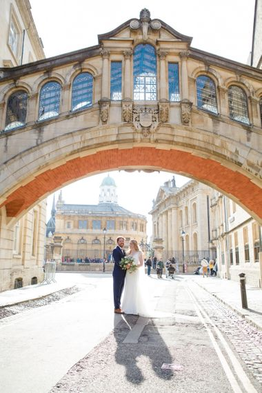 Bride in Sassi Holford Tamara Wedding Dress and Groom in Navy Ted Baker Suit in Oxford Streets