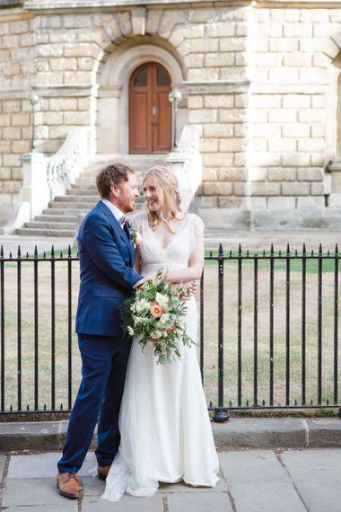 Bride in Sassi Holford Tamara Wedding Dress and Groom in Navy Ted Baker Suit Hugging