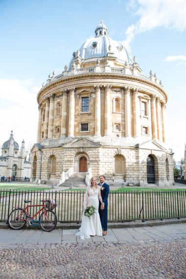 Bride in Sassi Holford Tamara Wedding Dress and Groom in Navy Ted Baker Suit in Oxford
