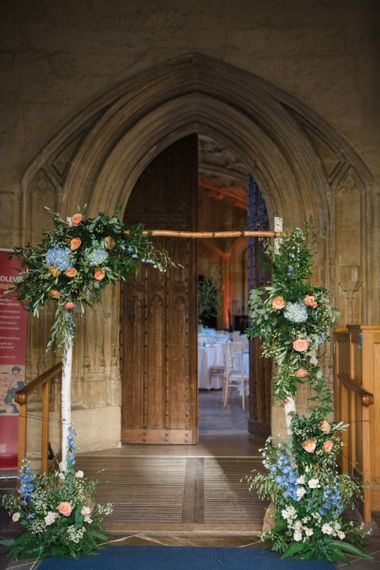 Branch Frame Altar with Coral and Blue Floral Wedding Flowers