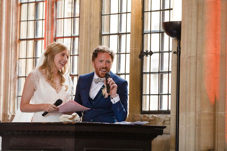 Joint Bride and Groom Speech with Bride in Sassi Holford Tamara Wedding Dress and Groom in Navy Ted Baker Suit