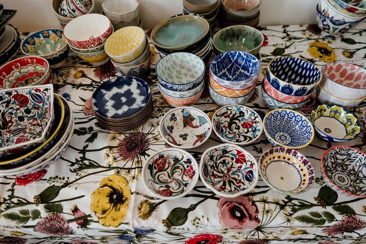 Bright multi-coloured tableware for Persian styled sharing banquet