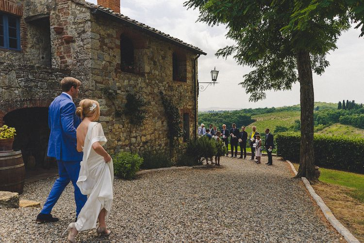 Intimate Prosecco Pool Party Wedding in Tuscany. Bride wears Livio Lacurre Gown, Groom wears Beggars Run Custom Suit. Photography by Livio Lacurre.