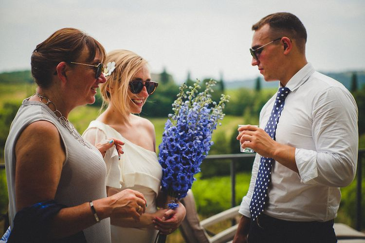 Flowers by Stiatti Fiori. Intimate Prosecco Pool Party Wedding in Tuscany. Bride wears Livio Lacurre Gown, Groom wears Beggars Run Custom Suit. Photography by Livio Lacurre.