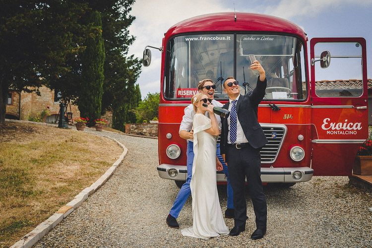 Vintage Bus Wedding Transport from Drive in Style. Intimate Prosecco Pool Party Wedding in Tuscany. Bride wears Livio Lacurre Gown, Groom wears Beggars Run Custom Suit. Photography by Livio Lacurre.