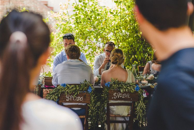 Flowers by Stiatti Fiori. La Pieve Marsina. Intimate Prosecco Pool Party Wedding in Tuscany. Bride wears Livio Lacurre Gown, Groom wears Beggars Run Custom Suit. Photography by Livio Lacurre.