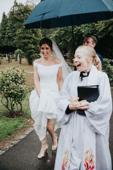 Bride in Suzanne Neville wedding dress arriving at church