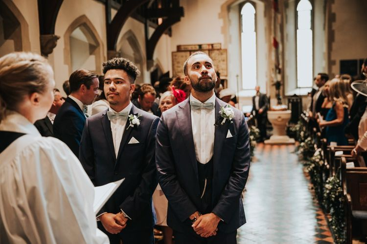 Groom waits for bride to walk down the aisle