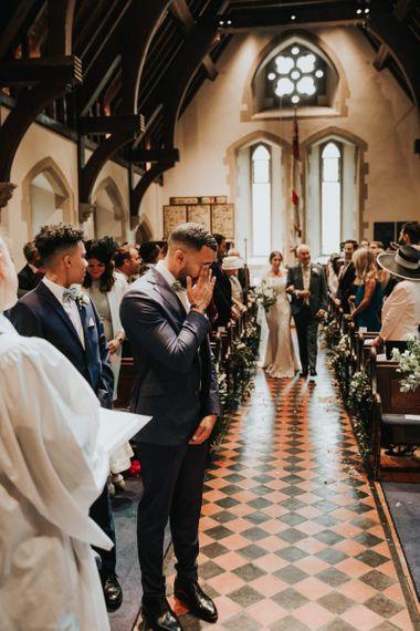 Emotional groom as he sees bride
