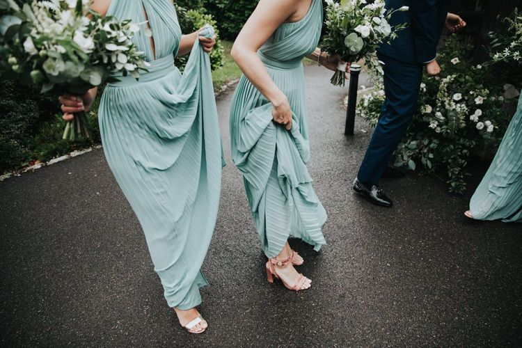 Green bridesmaid dresses for country wedding at Bury Court Barn
