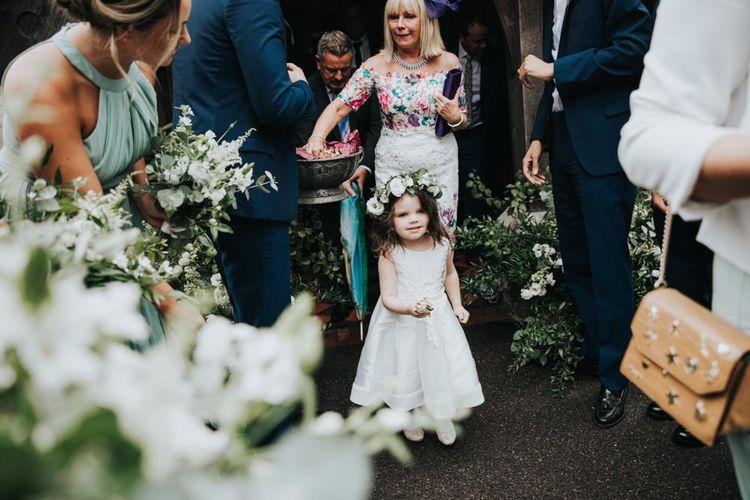 Flower girl in white dress and flower crown