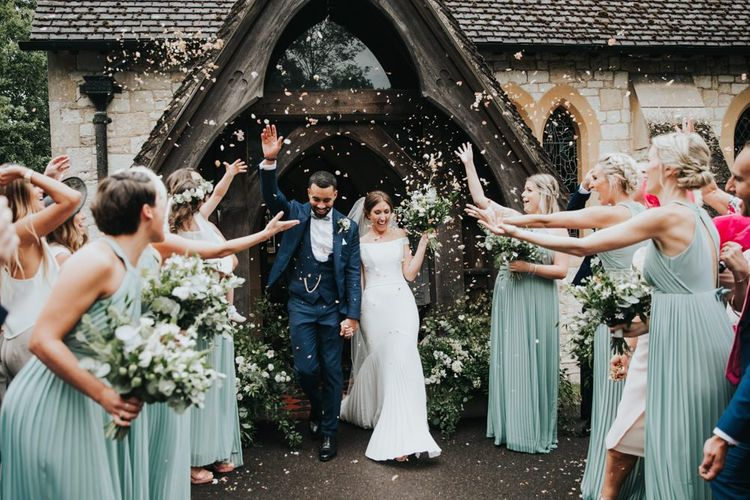 Confetti exit for bride and groom at church ceremony