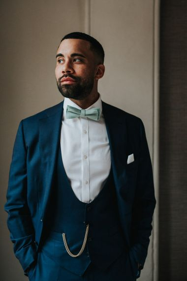 Groom in blue wedding suit and bowtie