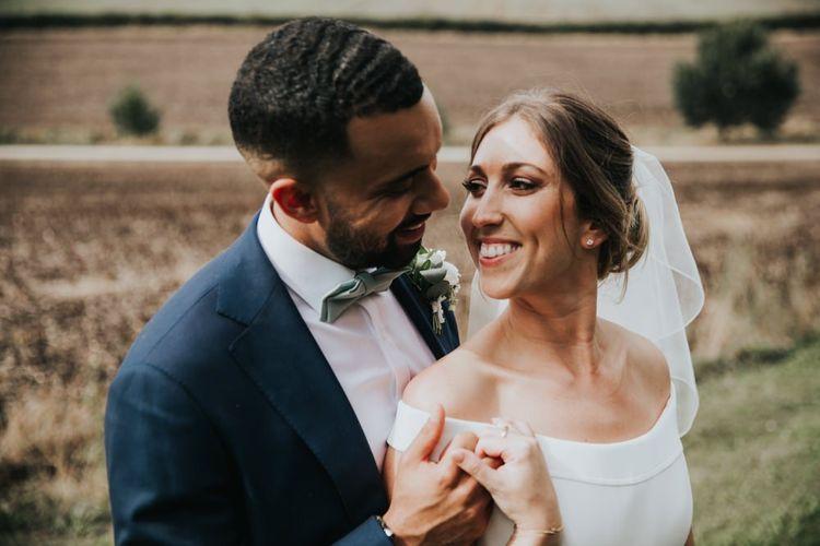 Off the shoulder wedding dress for bride at Bury Court Barn