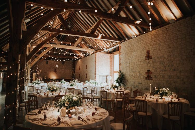 Bury Court Barn wedding breakfast with festoon lighting
