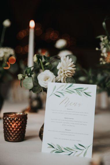 Foliage decorated wedding stationery