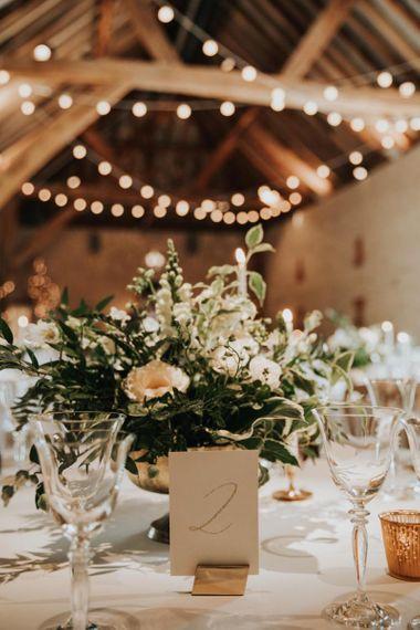White wedding flower table decor at Bury Court Barn