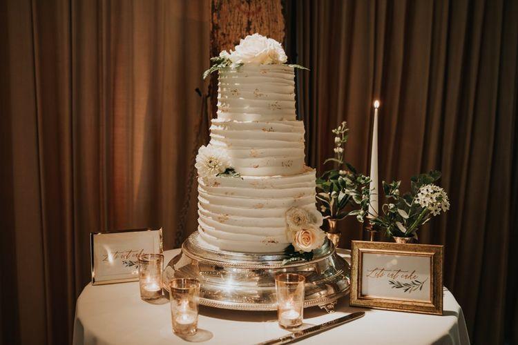 Rustic white wedding cake at Bury Court Barn