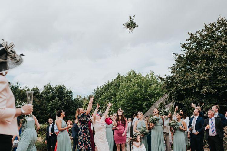 Bouquet toss at Bury Court Barn wedding