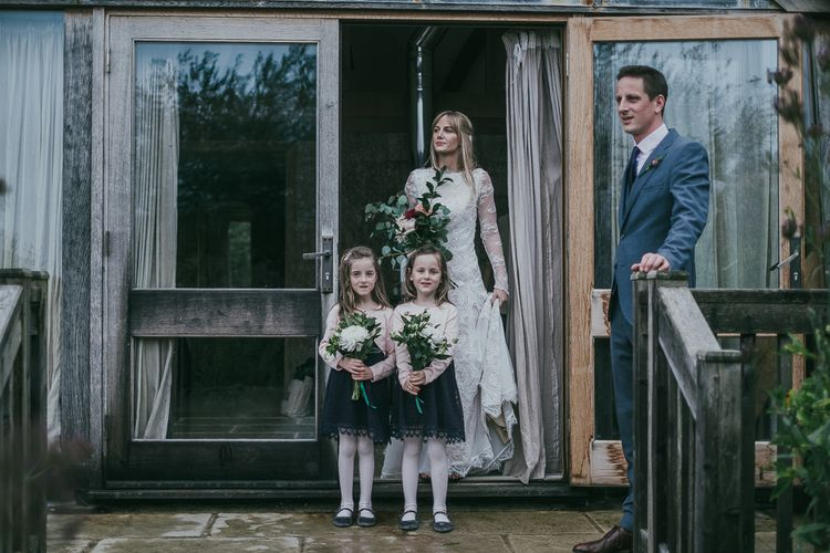Bride and Flower Girls in Navy Dresses from H&M
