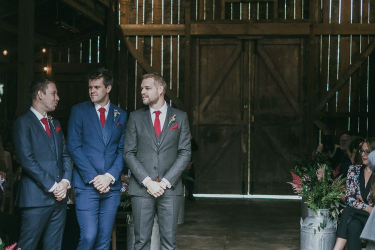 Groomsmen at the Altar in Moss Bros. Grey and Blue Suits