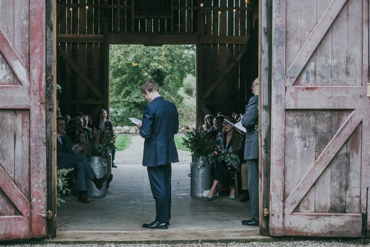 Groomsmen Giving a Wedding Reading standing in the Barn Door